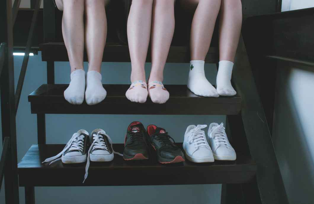 three pairs of low top sneakers