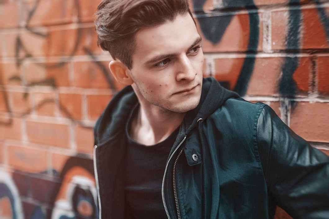 close up photography of man wearing leather jacket