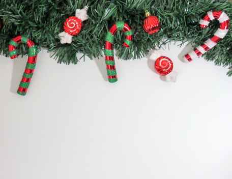 close up of christmas decorations hanging on tree