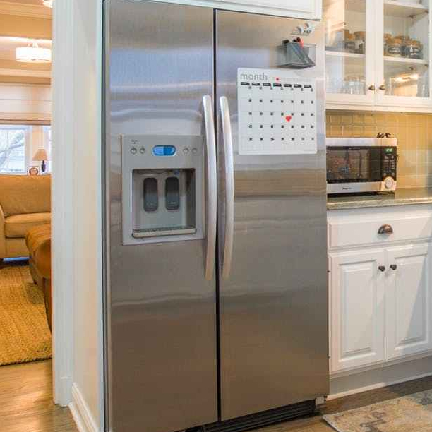 closed side by side refrigerator in kitchen area