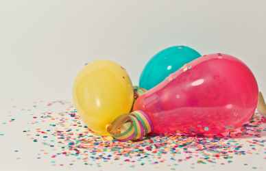 yellow pink and blue party balloons