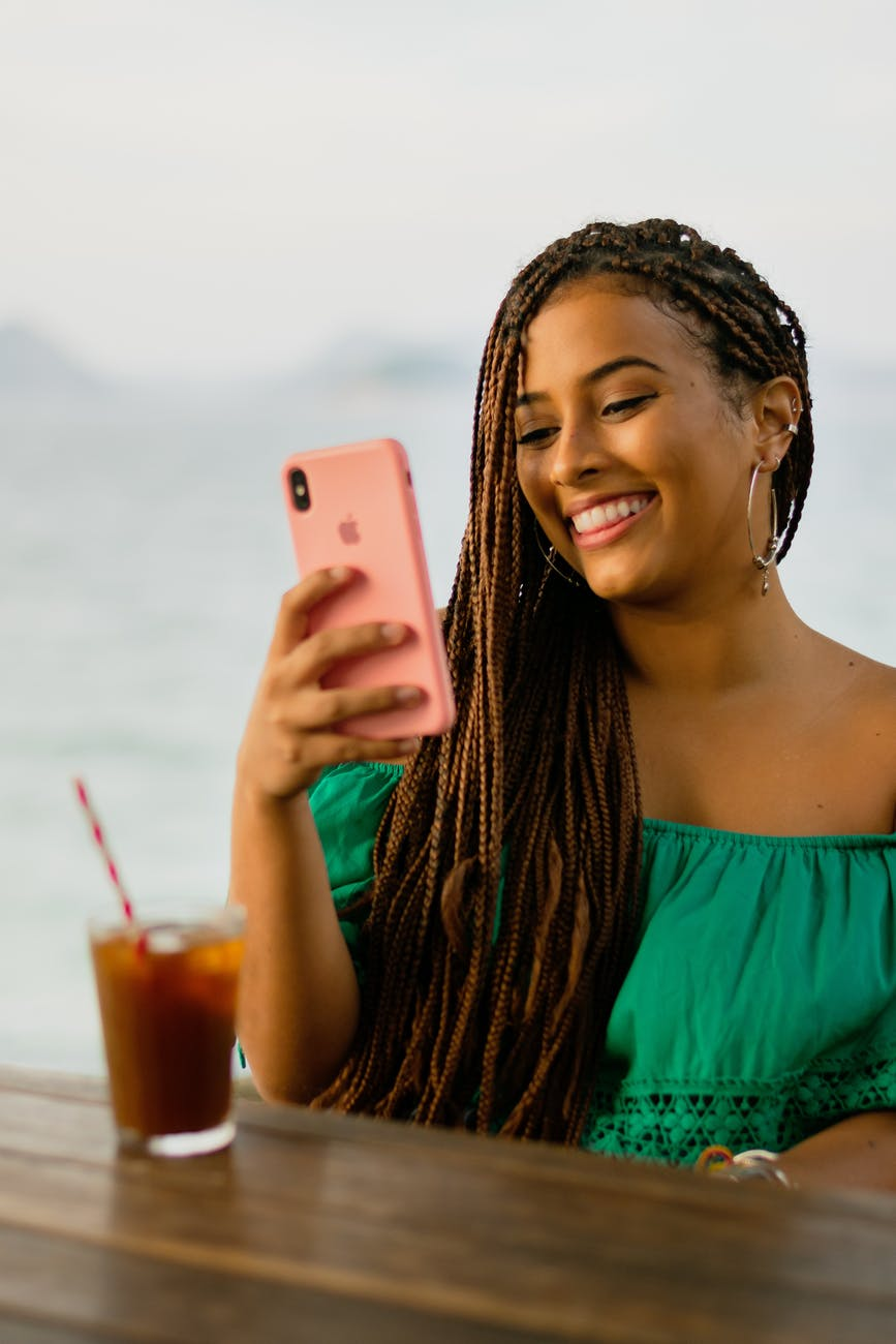 photo of a woman using her iphone